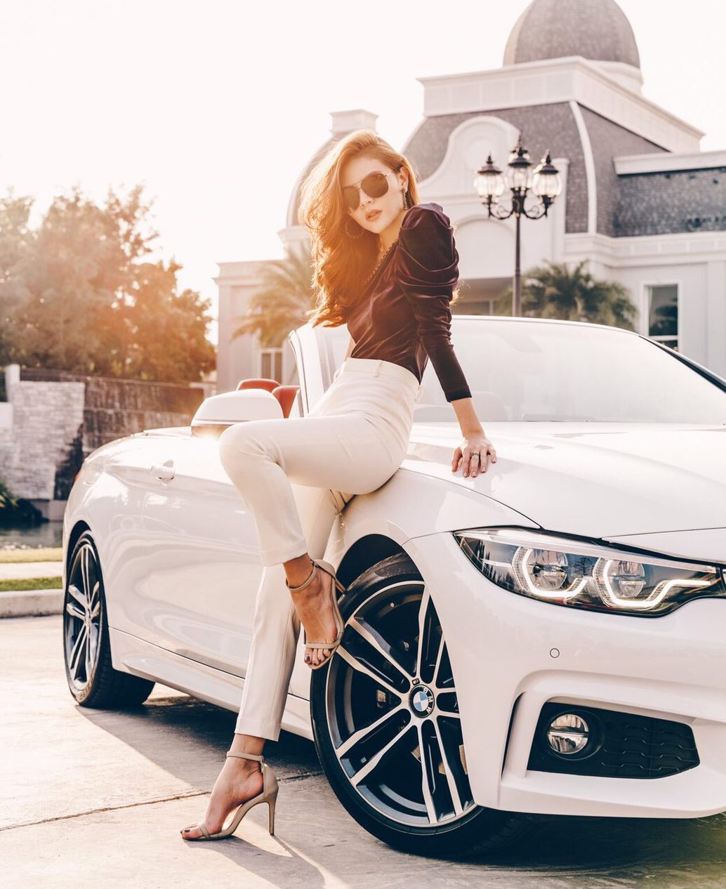 An attractive girl renting convertible car with Prime Cars Rental